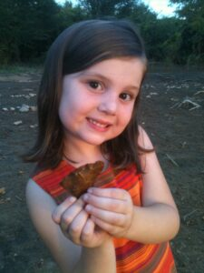 My daughter Emily with one of her finds.