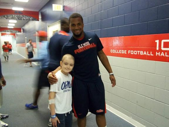 Chance Tetrick gets a VIP tour from Ole MIss WR Donte Mocrief. Photo courtesy of Jeff Tetrick